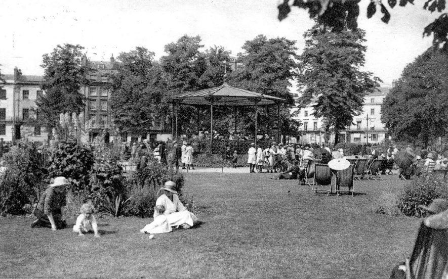 People relaxing in the pump room gardens and listening to a band playing in the bandstand, Leamington Spa.  1920s |  IMAGE LOCATION: (Warwickshire County Record Office)