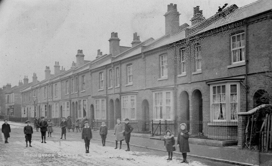 Children standing in front of terraced houses in Tachbrook Street, Leamington Spa.  1900s |  IMAGE LOCATION: (Warwickshire County Record Office)