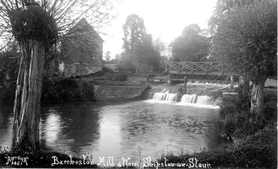 Barcheston Mill and weir with wooden footbridge.  1930s |  IMAGE LOCATION: (Warwickshire County Record Office)