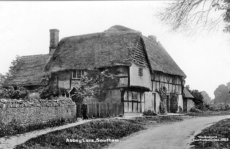 A thatched and half timbered cottage in Abbey Lane, Southam.  1900s |  IMAGE LOCATION: (Warwickshire County Record Office)