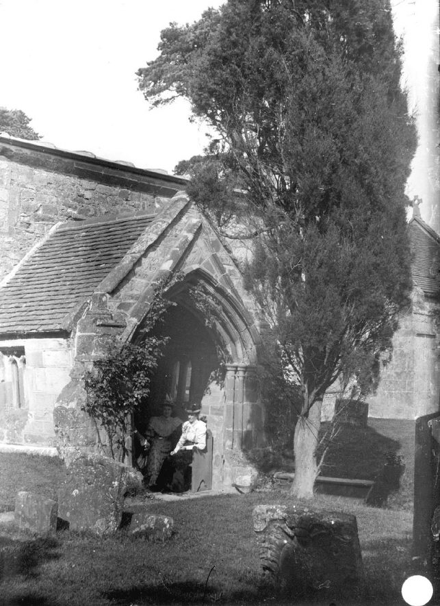 Two ladies sitting in the porch of St Gregory's church, Offchurch.  1900s |  IMAGE LOCATION: (Warwickshire Museums. Photographic Collections.)