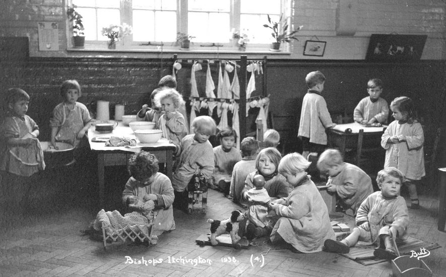 Group of children at play in a classroom at Bishops Itchington school.  1933 |  IMAGE LOCATION: (Warwickshire County Record Office)