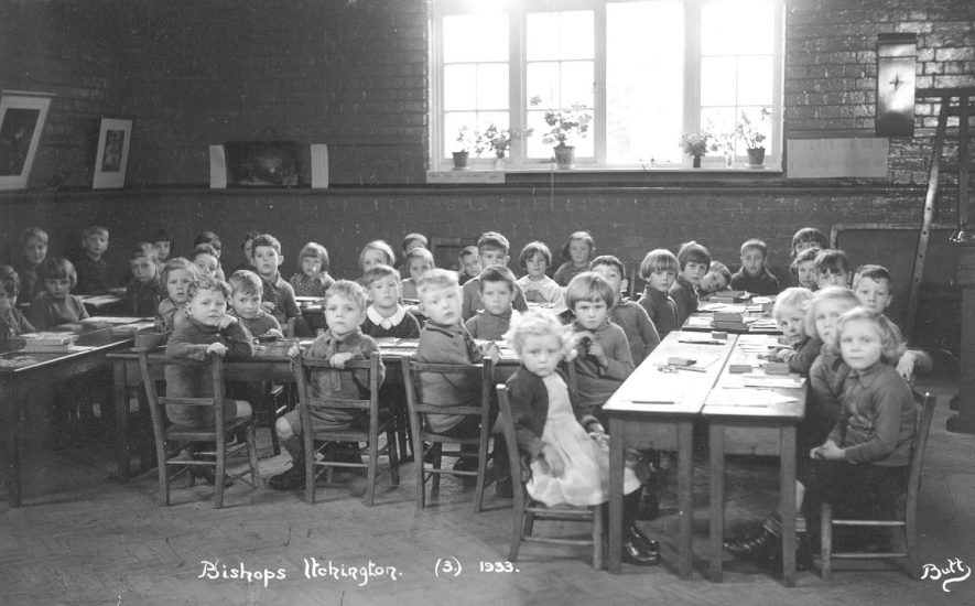 Group of children sitting at tables in a classroom at Bishops Itchington school.  1933 |  IMAGE LOCATION: (Warwickshire County Record Office)