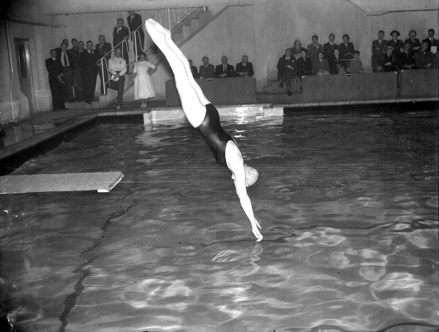 Reopening of swimming baths in Leamington Spa by Anthony Eden.  Shows a girl diving.  27 October 1956 |  IMAGE LOCATION: (Warwickshire County Record Office) PEOPLE IN PHOTO: Eden as a surname, Eden, Anthony