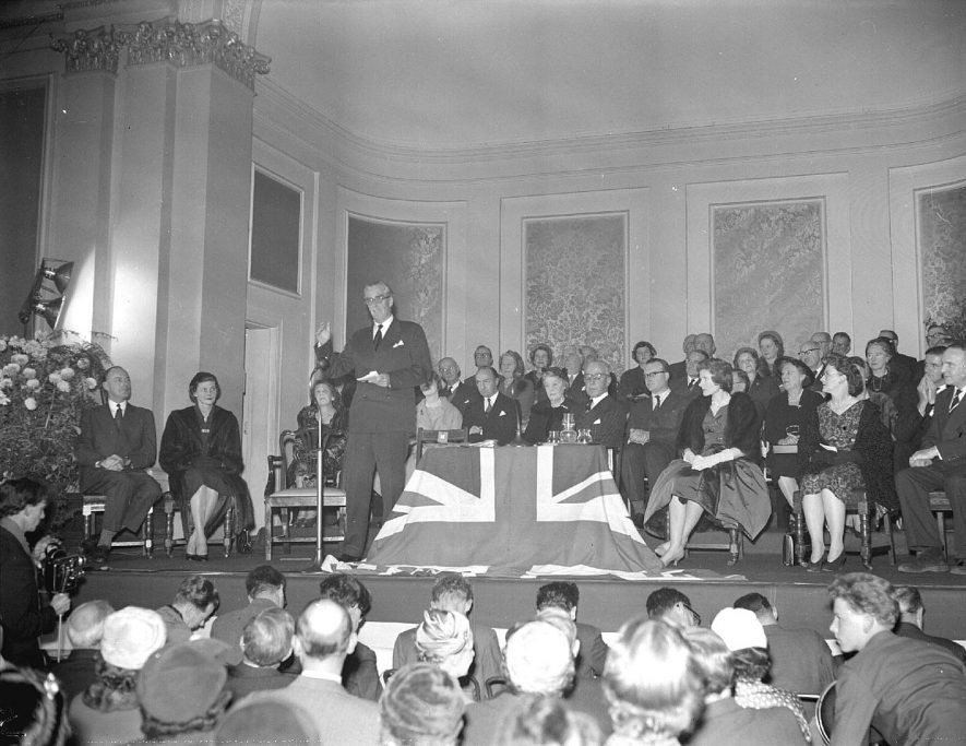Presentation to Sir Anthony Eden on stage at Leamington Spa Town Hall present were Mr & Mrs Hobson, Mr & Mrs Wilson and Lord Willoughby de Broke.  28 November 1958 |  IMAGE LOCATION: (Warwickshire County Record Office) PEOPLE IN PHOTO: Wilson as a surname, Willoughby, Lord de Broke, Hobson as a surname, Eden, Mrs, Eden as a surname, Eden, Anthony