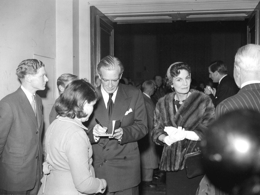 Presentation to Sir Anthony Eden, signing autographs.  1958 |  IMAGE LOCATION: (Warwickshire County Record Office) PEOPLE IN PHOTO: Eden, Mrs, Eden, Anthony