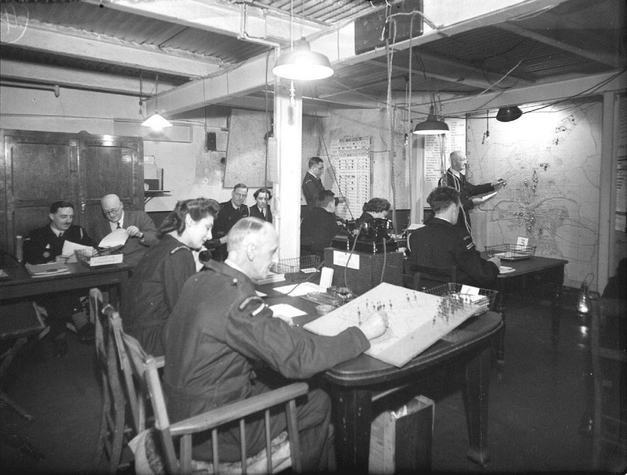 A.R.P. Control Centre, Jephson Villas, Leamington Spa. Civil Defence personnel at work.  22nd June, 1945 |  IMAGE LOCATION: (Warwickshire County Record Office)