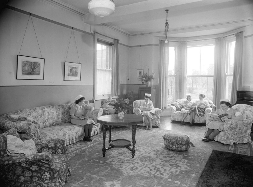 Nurses' Rest Room, showing nurses sitting down, at the Warneford Hospital, interior, Leamington Spa.  31st May 1949 |  IMAGE LOCATION: (Warwickshire County Record Office)