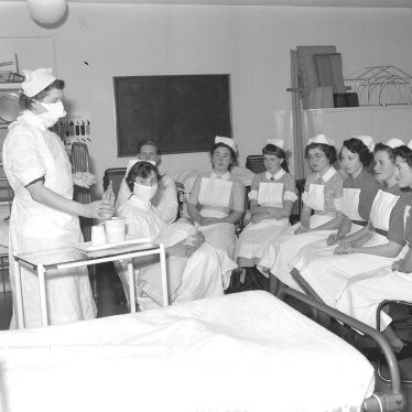 Leamington Spa.  Nurses learning baby-feeding