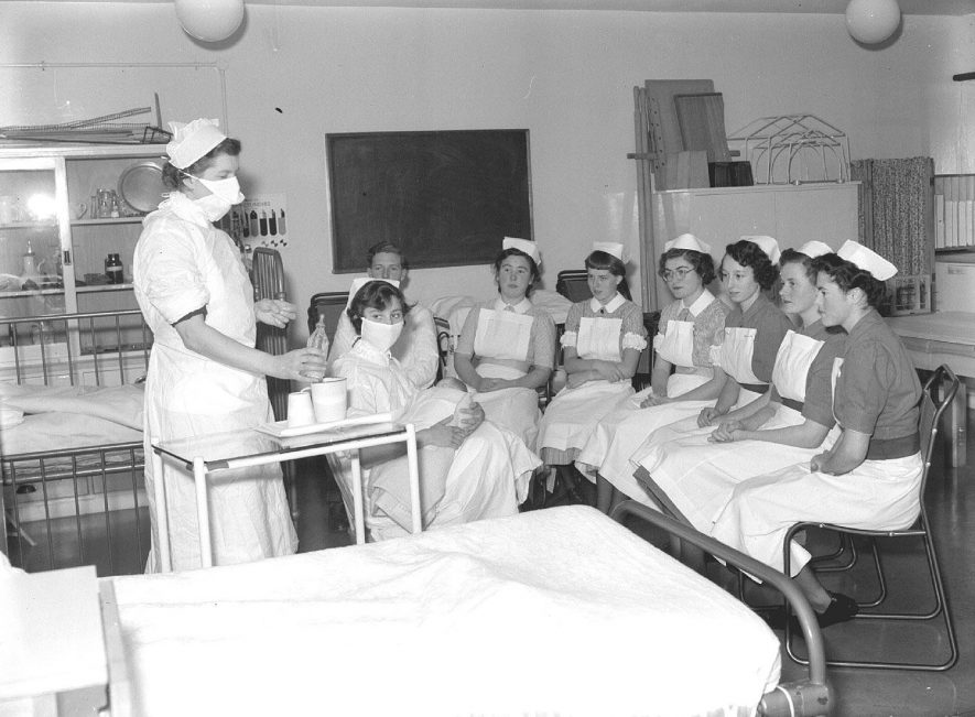 Nurses learning how to feed a baby at the Nurses' Home, Leamington Spa. 1954i2 St Mary's Road. 23rd September 1954 |  IMAGE LOCATION: (Warwickshire County Record Office)