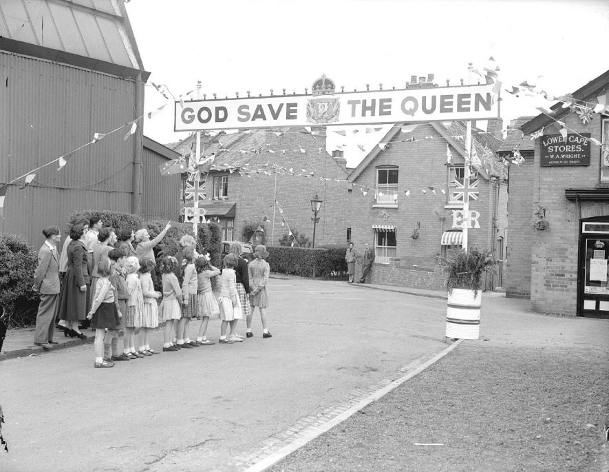 Lower Cape, Warwick. Group of children looking at decorations for Coronation of Elizabeth II.  June 1953 |  IMAGE LOCATION: (Warwickshire County Record Office)