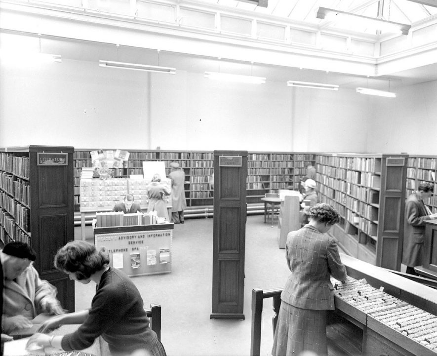 Leamington Spa Public Library interior with staff.  October 1960 |  IMAGE LOCATION: (Warwickshire County Record Office)