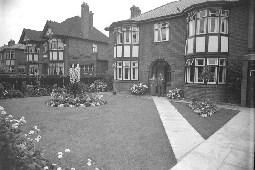Yucca plant growing in the front garden of M.G.C. Achers of Lillington.  1951 |  IMAGE LOCATION: (Warwickshire County Record Office)