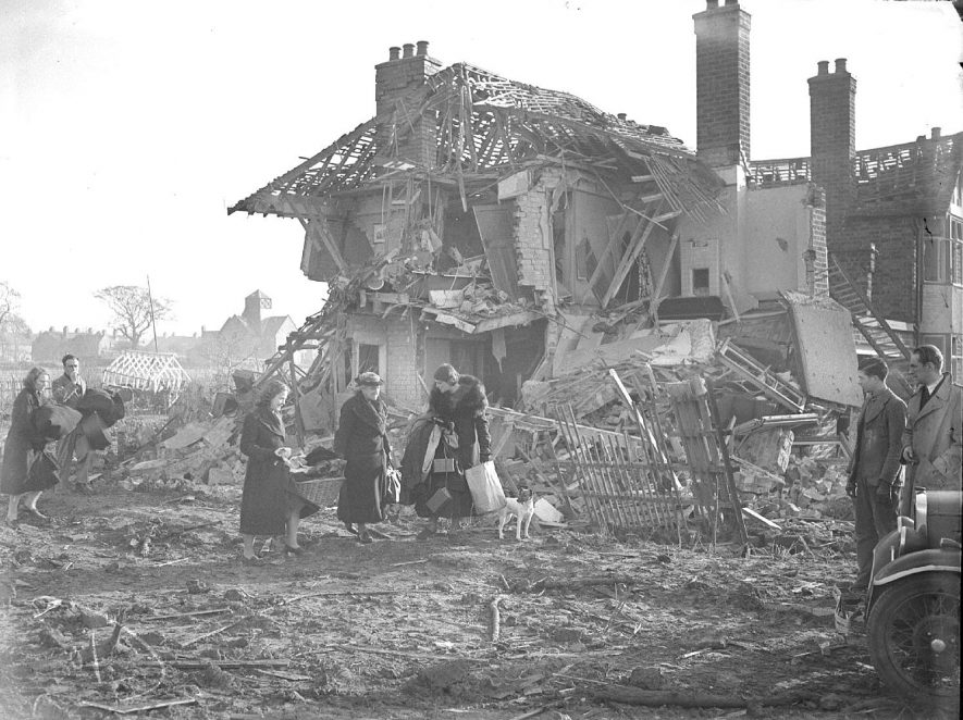 Family salvaging possessions after bomb damage in Telford Avenue, Lillington.  14th November 1940 |  IMAGE LOCATION: (Warwickshire County Record Office)