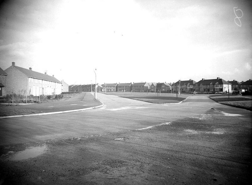 A housing estate in Lillington.  1940s   [This photo is taken from the road junction of Pound Lane, Valley Road to the left and Gresham Avenue ahead. The houses at the far side of the grass semi circle are on Cromer Road] |  IMAGE LOCATION: (Warwickshire County Record Office)