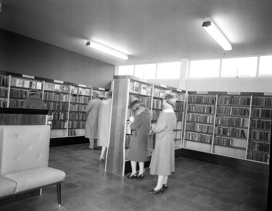 Lillington Public Library interior.  Public examining books on shelves.  1960 October 1960. |  IMAGE LOCATION: (Warwickshire County Record Office)