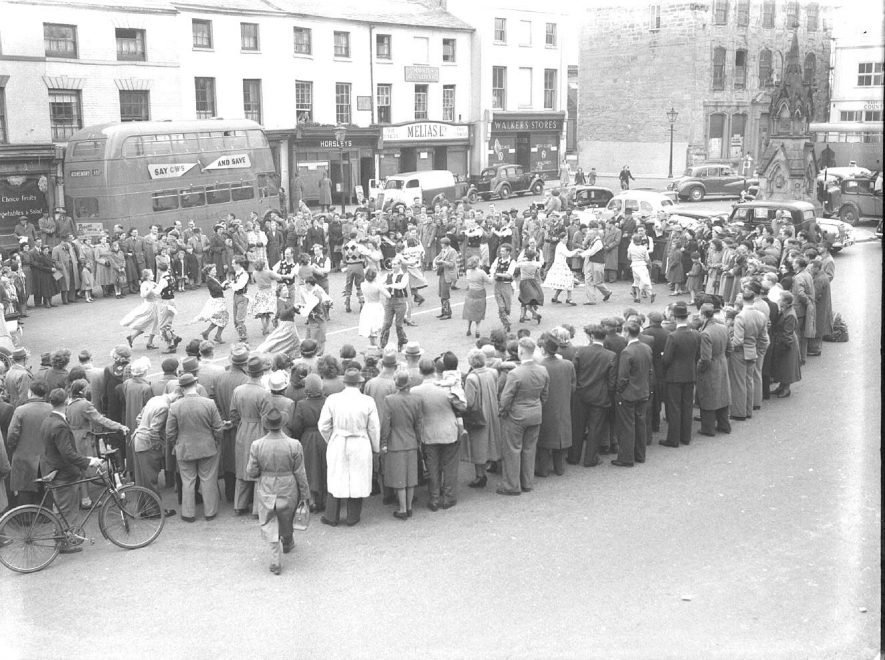 Folk dancing, in Warwick Market Square. 1950 |  IMAGE LOCATION: (Warwickshire County Record Office)