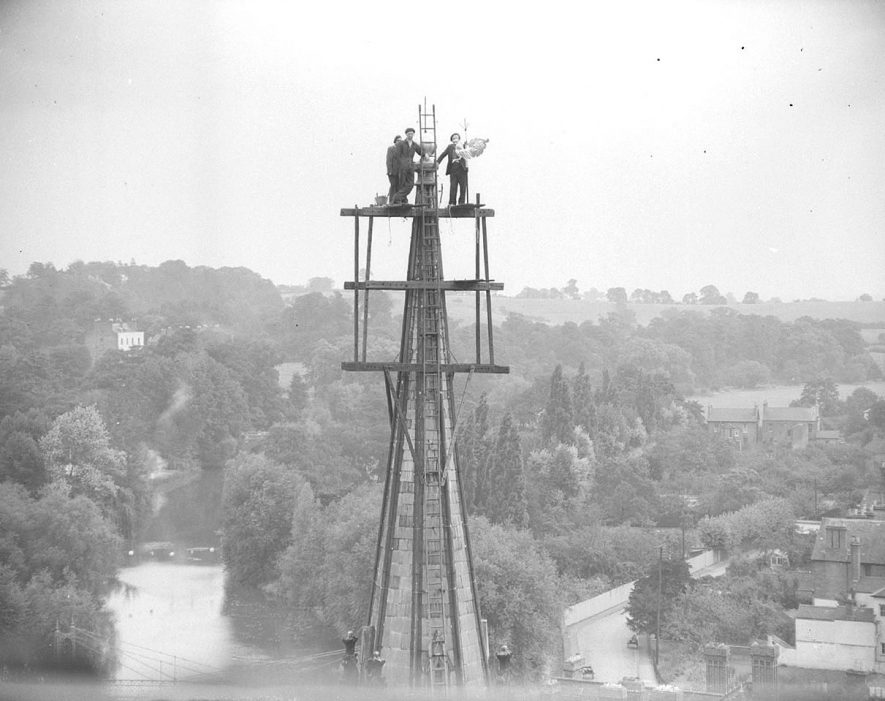 Men erecting weathercock on spire of All Saints Parish Church, Leamington Spa.  4th August 1952 |  IMAGE LOCATION: (Warwickshire County Record Office)