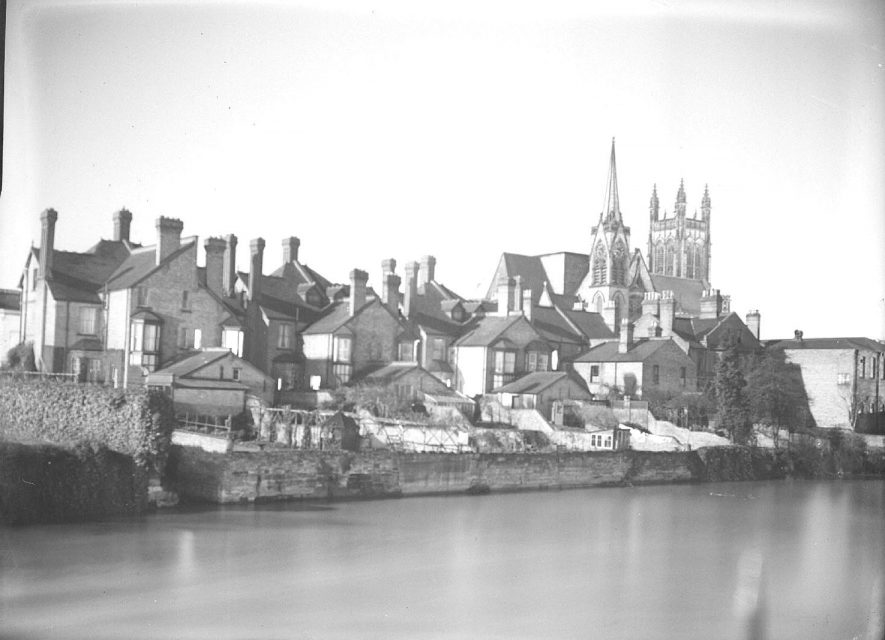 View over River Leam in moonlight from suspension bridge, with All Saint's Church in the background.  1938 |  IMAGE LOCATION: (Warwickshire County Record Office)