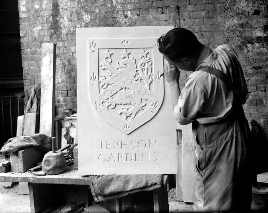 Stonemason working on the Jephson Coat of Arms for the Newbold Terrace entrance gates.  1952 |  IMAGE LOCATION: (Warwickshire County Record Office)