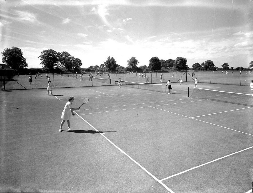 Kingsley School tennis courts with players, Leamington Spa.  1950s |  IMAGE LOCATION: (Warwickshire County Record Office)