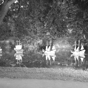 Leamington Spa.  Illuminated model boats on the river