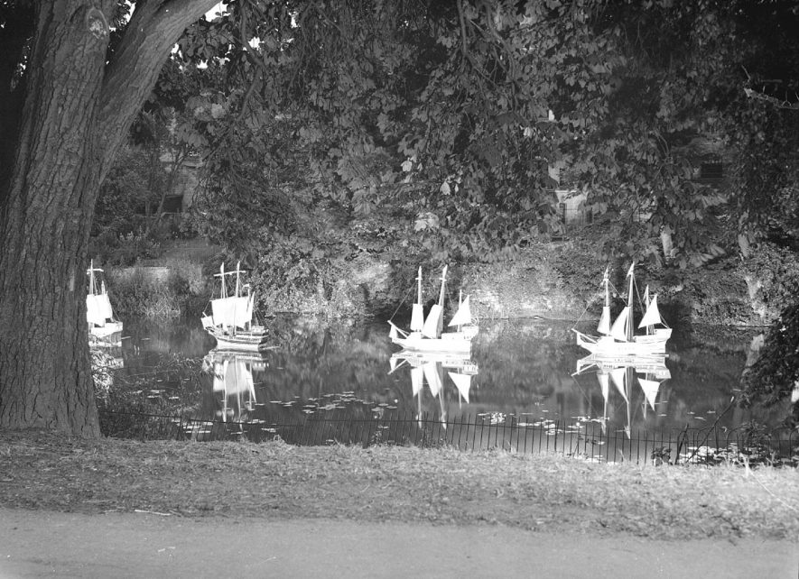Illuminated model boats on river in Jephson Gardens, Leamington Spa. Photograph from  Leamington Lights series.  29th July 1953 |  IMAGE LOCATION: (Warwickshire County Record Office)