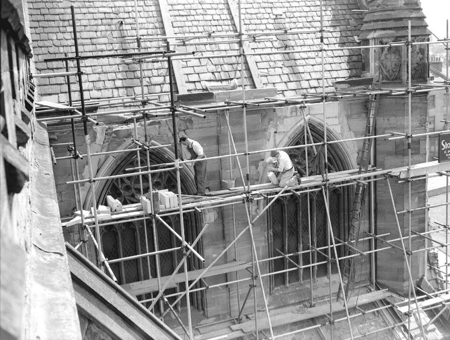 Stonemasons working on the windows of the parish church in June 1956 |  IMAGE LOCATION: (Warwickshire County Record Office)