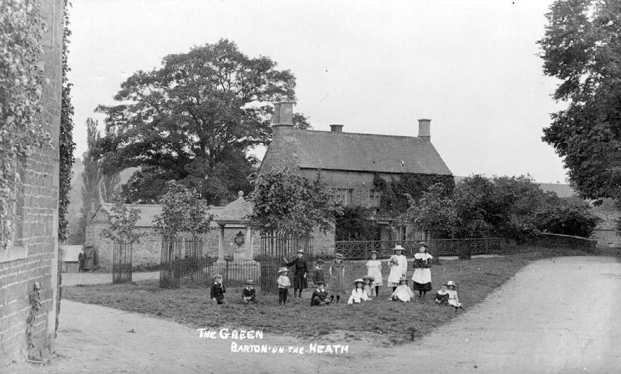 The Green, Barton on the Heath, showing a group of children beside the  seventeenth wellhouse. One child is carrying a cricket bat.  1900s |  IMAGE LOCATION: (Warwickshire County Record Office)