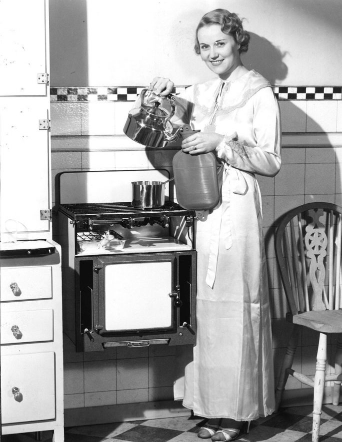 Wall mounted gas cooker being demonstrated.  1936 |  IMAGE LOCATION: (Warwickshire County Record Office)