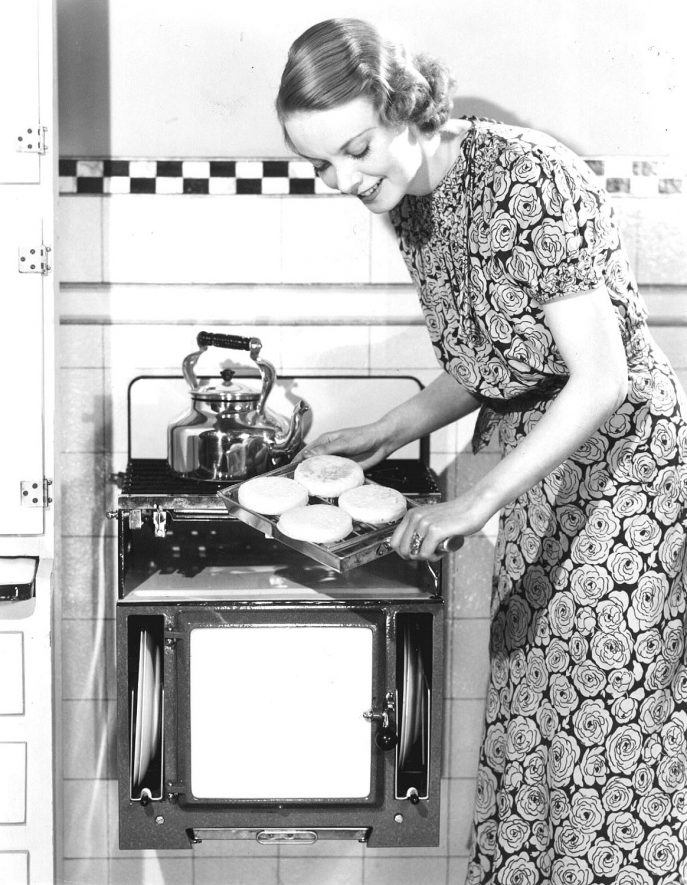 Cookery demonstration on a wall mounted cooker.  1936 |  IMAGE LOCATION: (Warwickshire County Record Office)