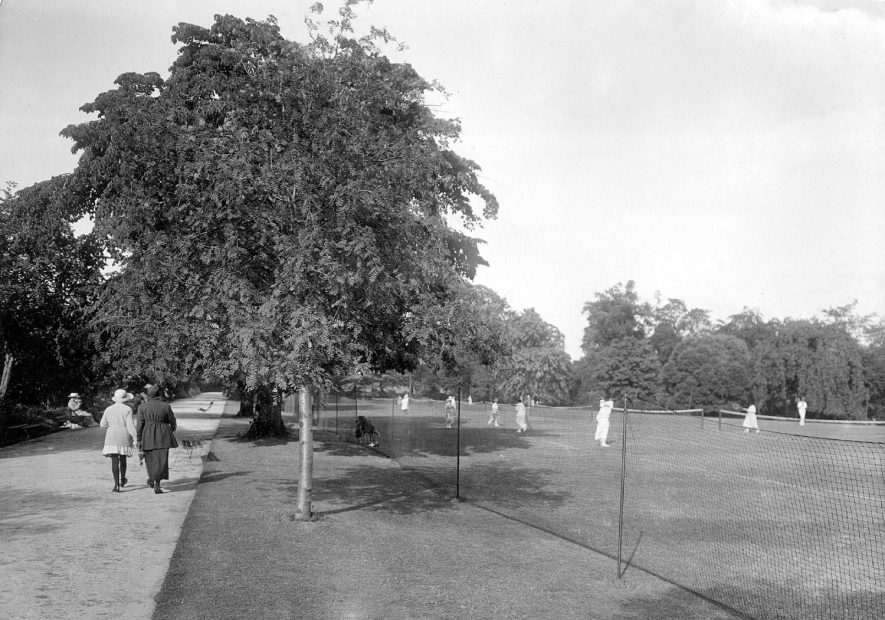 Tennis in the Pump Room Gardens, Leamington Spa. 1920s[This looks most like the lawn in the upper Jephson Gardens, looking parallel to Newbold Terrace . Tennis was played here from at least 1880 to 1942. It is not thought that the Pump Room Gardens ever had tennis courts. The venues for tennis were Jephson Gardens, Victoria Park, Christchurch Gardens and Guy's Cliffe Avenue.] |  IMAGE LOCATION: (Warwickshire County Record Office)