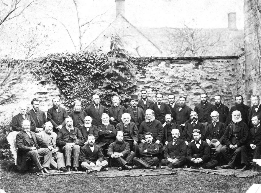 Group of gentlemen presumably office bearers of the Leamington Methodist church photographed in the church garden with their pastor.  1890s |  IMAGE LOCATION: (Warwickshire County Record Office)