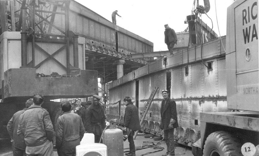 Demolition of railway bridges at High Street, Leamington Spa, one side of the bridge resting on the road.  1968 |  IMAGE LOCATION: (Warwickshire County Record Office)