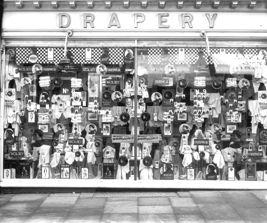 Woodward's Drapery, The Parade, Leamington Spa.  Shop window with display of Wolsey underwear.  1930s |  IMAGE LOCATION: (Warwickshire County Record Office)