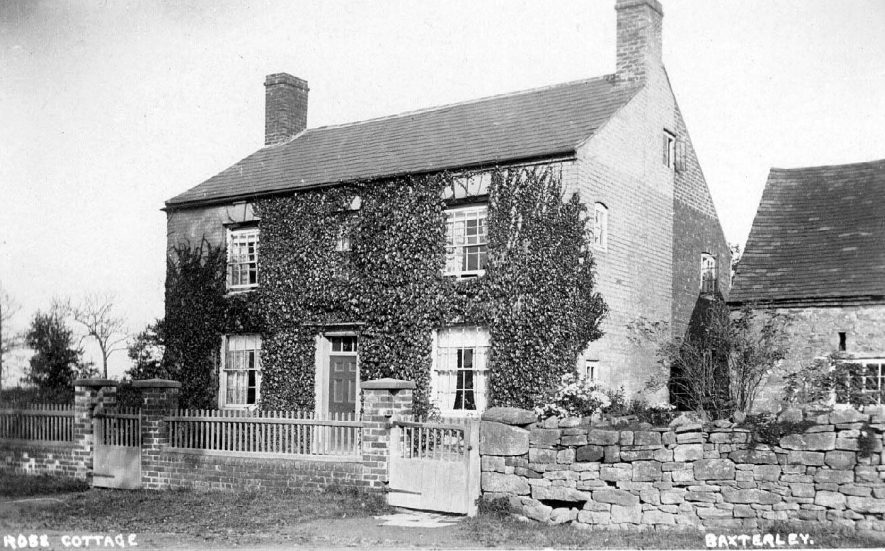Rose Cottage, Baxterley, creeper covered cottage with wall and fence.  1900s |  IMAGE LOCATION: (Warwickshire County Record Office)