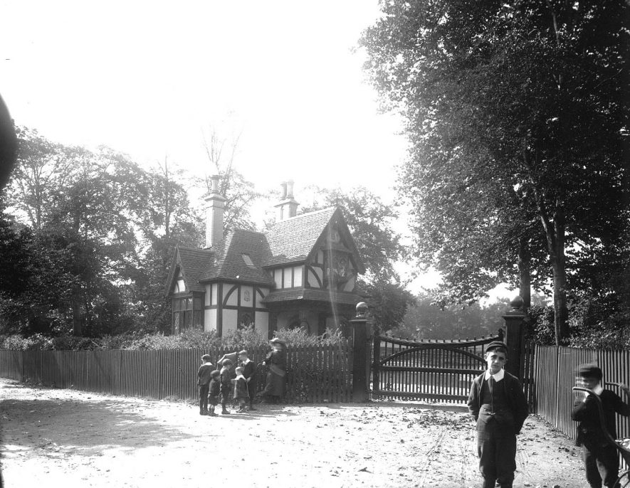 The Lodge & gates to Shrubland Hall (school) on the Tachbrook Road, showing scholars outside the gate, Leamington Spa.  1900s |  IMAGE LOCATION: (Warwickshire County Record Office)