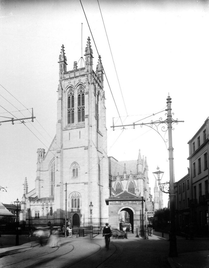 All Saints Church and the Aylesford Well, seen from Spencer Street, Leamington Spa.  1900s |  IMAGE LOCATION: (Warwickshire County Record Office)