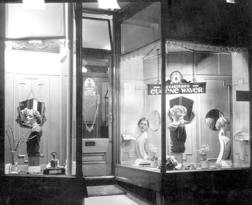 Shop window of ladies' hairdressers, with display of permanent wave styles, Leamington Spa.  1930s |  IMAGE LOCATION: (Warwickshire County Record Office)