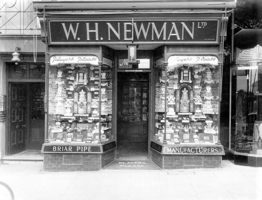 Shop front of W.H. Newman Ltd., tobacconist., 106, The Parade, Leamington Spa, showing window display.  1930s |  IMAGE LOCATION: (Warwickshire County Record Office)