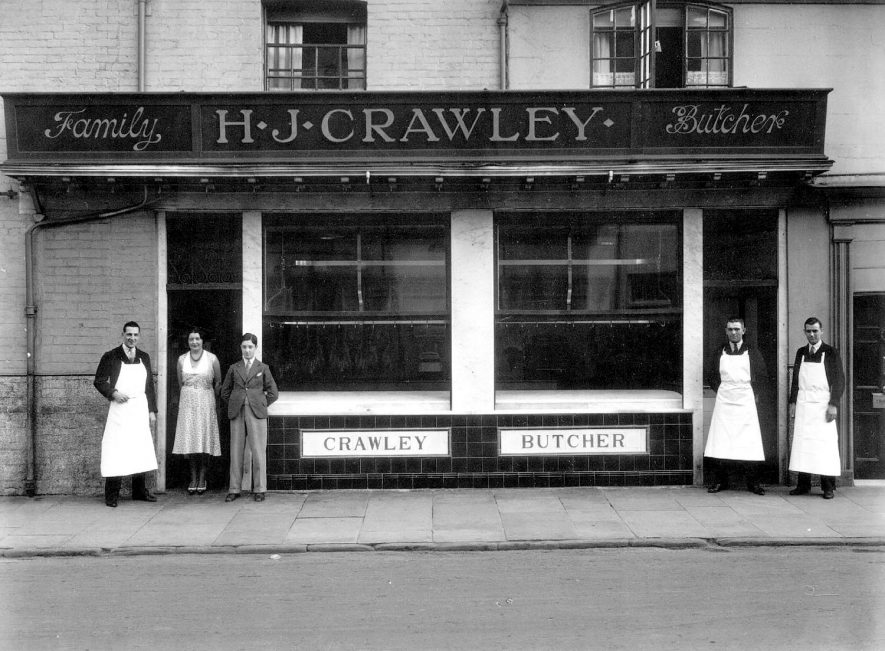 Shop front of H.J. Crawley, butcher, 122, Regent Street, Leamington Spa, with four male and one female staff.  1930s |  IMAGE LOCATION: (Warwickshire County Record Office)