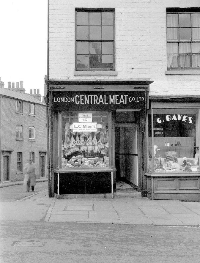 54 & 56 Clemens Street, Leamington Spa, on corner of West Street. London Central Meat Co. Ltd. and G. Bayes, boot repairer.  22nd January 1949 |  IMAGE LOCATION: (Warwickshire County Record Office)