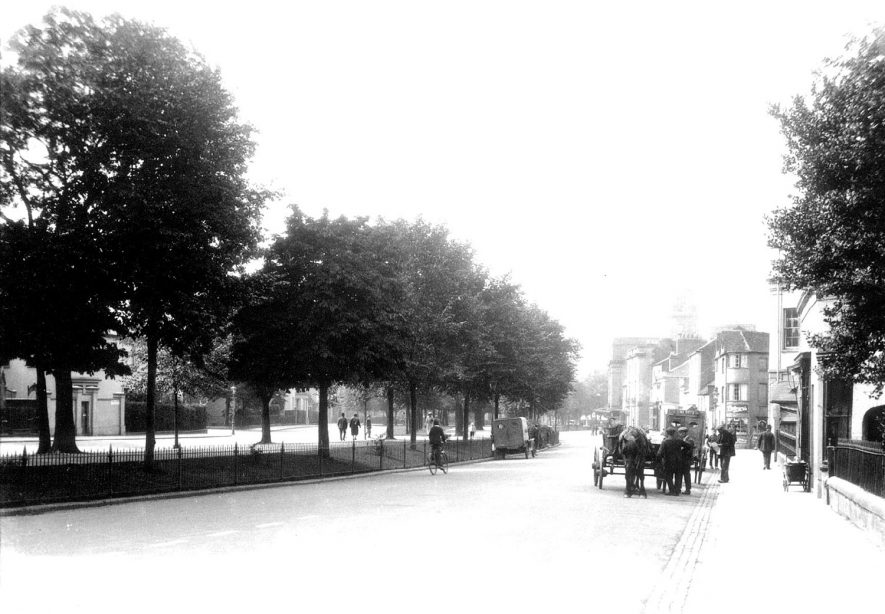 Holly Walk, Leamington Spa, showing pedestrians and horse-drawn vehicles, motor van and cyclist.  1920s |  IMAGE LOCATION: (Warwickshire County Record Office)
