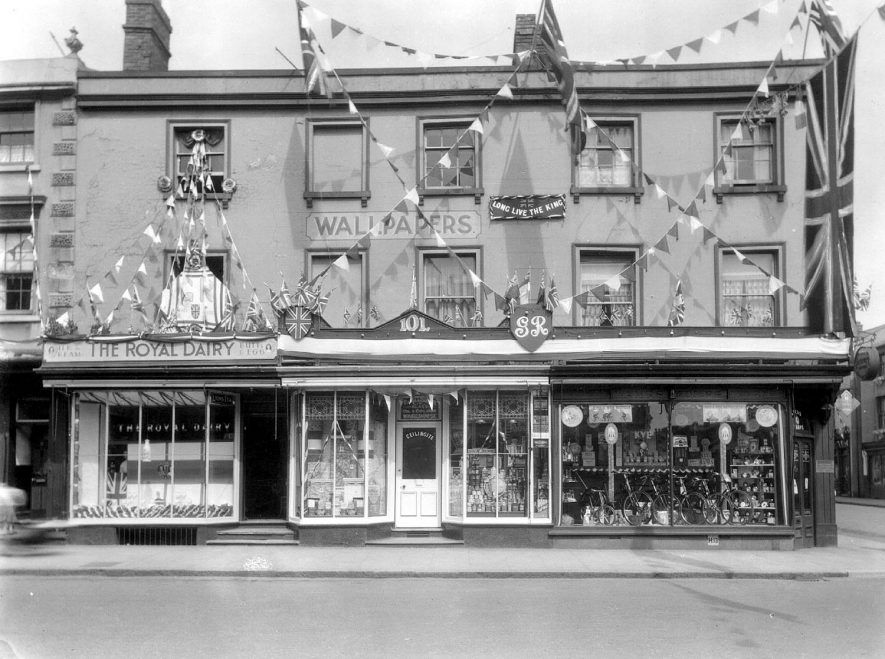 99-103, Warwick Street.  Royal Dairy, Harrisons glass and wallpaper and Bissell's cycle shop decorated for George V's silver jubilee, Leamington Spa.  1935 |  IMAGE LOCATION: (Warwickshire County Record Office)