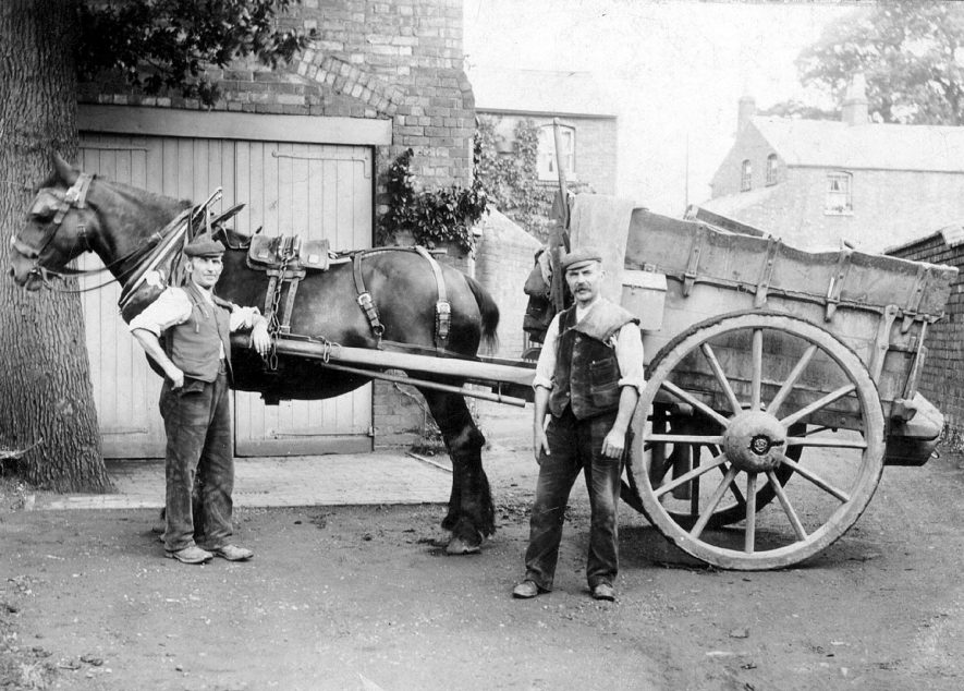 Two men with a horse and cart at the rear of Radford House, Kenilworth Road, Leamington Spa.  1900s |  IMAGE LOCATION: (Warwickshire County Record Office)
