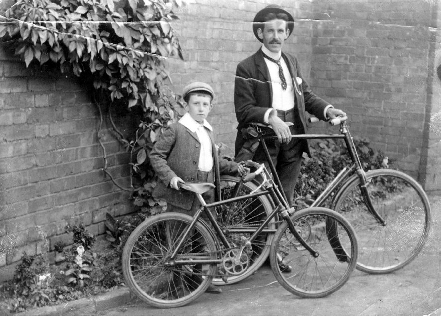 A man and a boy with their bicycles, Leamington Spa.  1900s |  IMAGE LOCATION: (Warwickshire County Record Office)