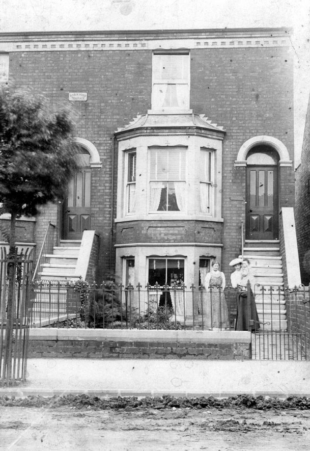 Two ladies standing before a house said to be in Robin Hood Terrace, Leamington Spa.  There is no indication as to where this might have been.  1900s |  IMAGE LOCATION: (Warwickshire County Record Office)