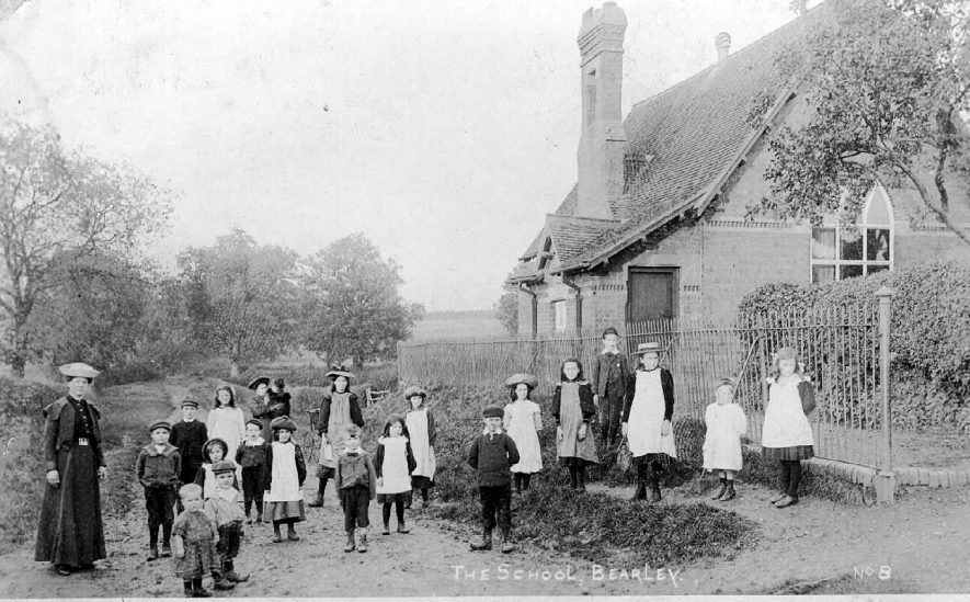 Bearley School. Group of pupils and teacher standing outside school.  1900s |  IMAGE LOCATION: (Warwickshire County Record Office)