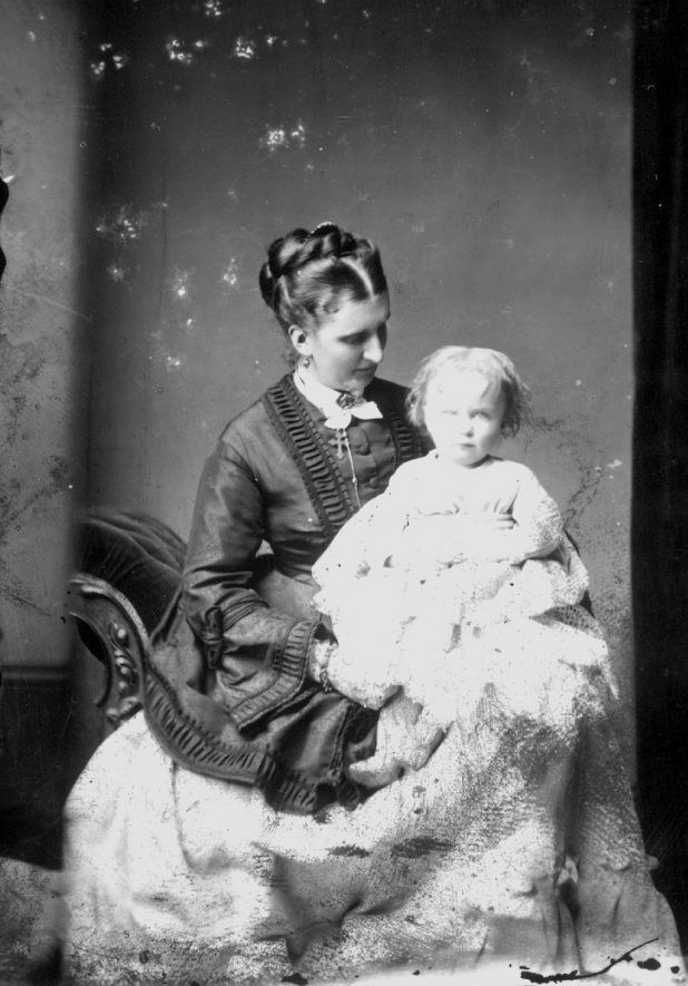 Portrait of a mother and child with the surname Compton.  1874    IMAGE LOCATION: (Warwickshire County Record Office) PEOPLE IN PHOTO: Compton as a surname