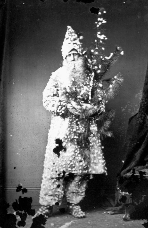 Portrait of a man with the surname Greenway dressed as Father Christmas.  1874 |  PEOPLE IN PHOTO: Greenway as a surname